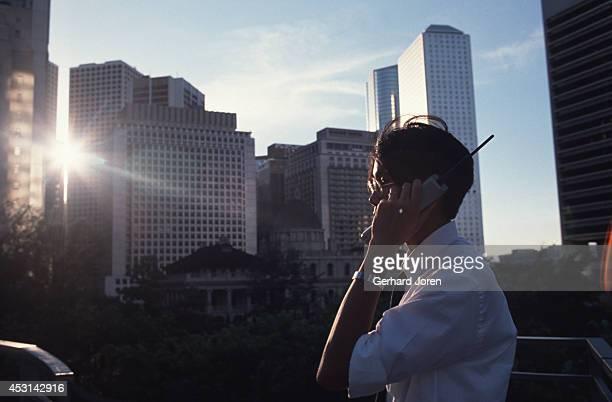 A business man making a phone call on Victoria Island Hong Kong