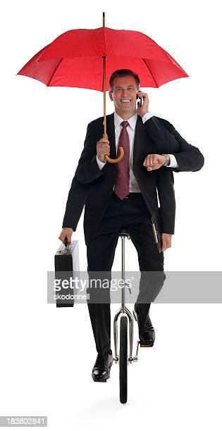 Business Mann Multitasking auf Einrad