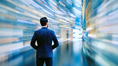 Business man observing fast speed dataflow.