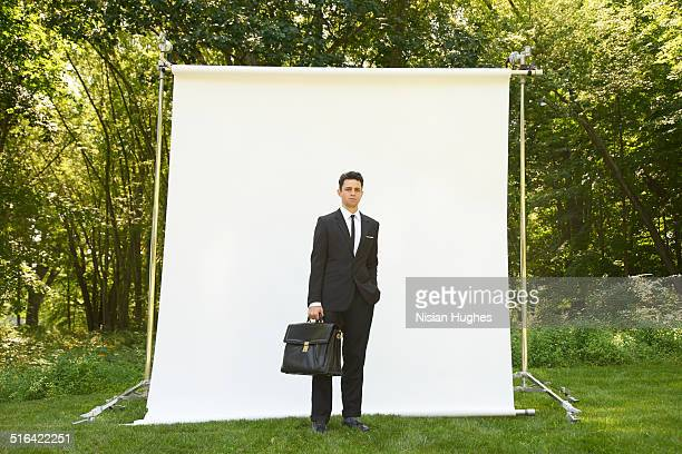 Business man on backdrop in nature
