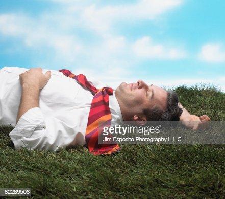 Business Man on Grass : Stock-Foto