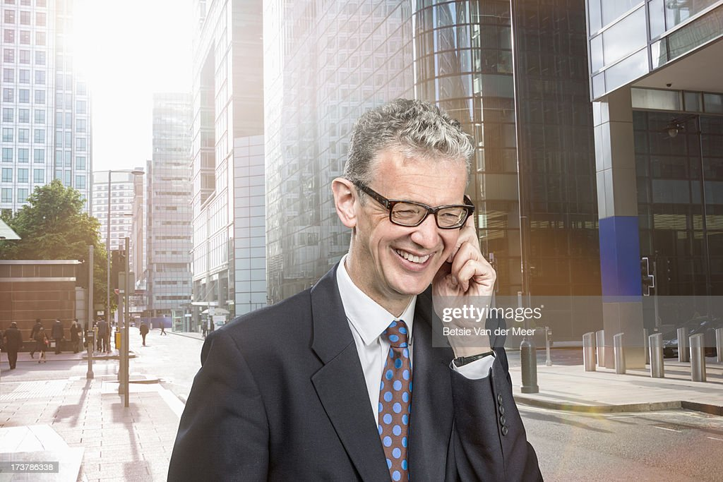 Business man on phone walking in city. : Stock Photo