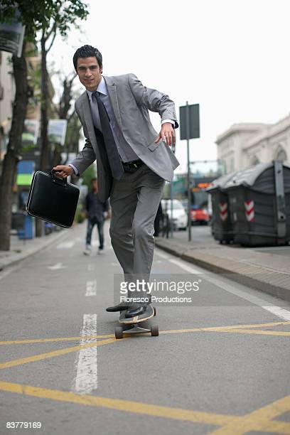 Business man on skateboard