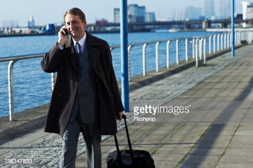 Business man on the move using mobile phone