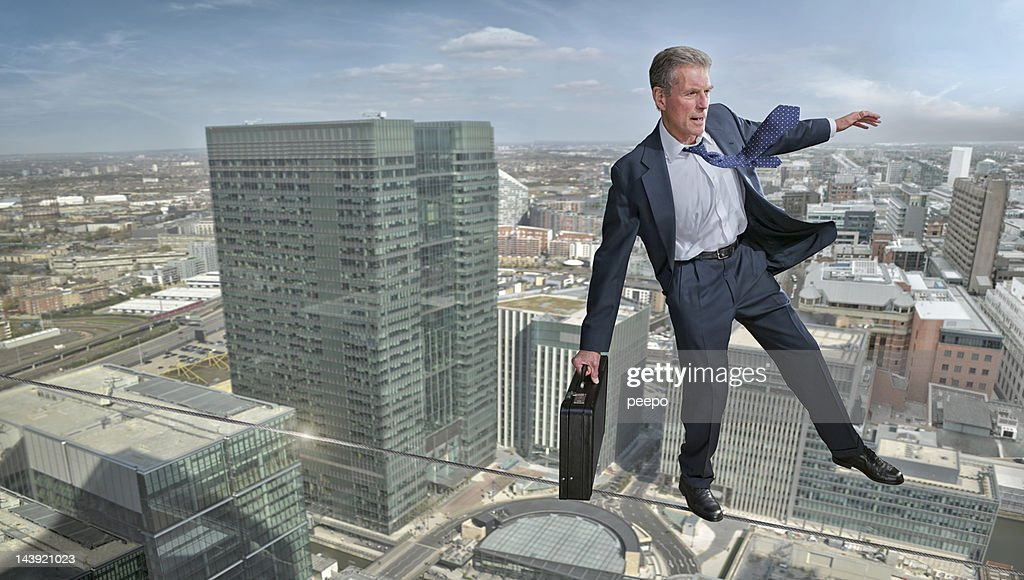 Business Man on Tightrope