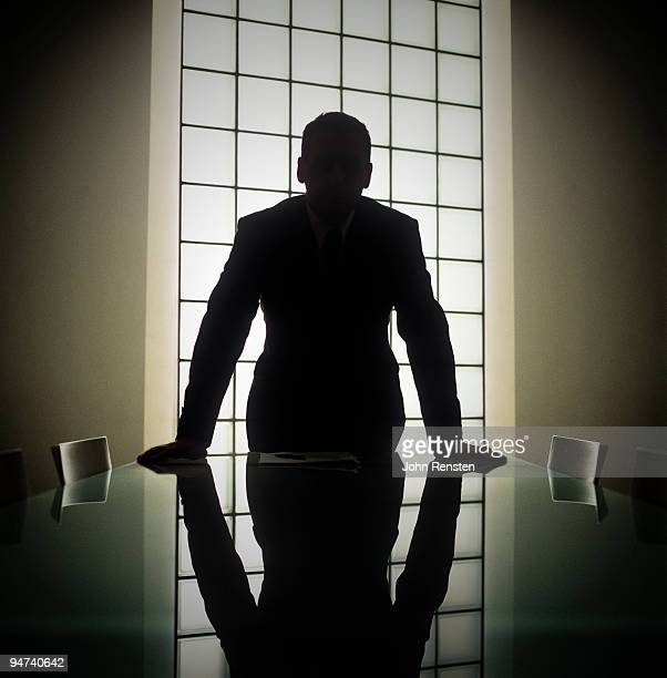Business man or boss in silhouette interview