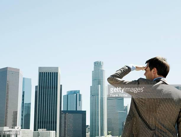 business man overlooking city