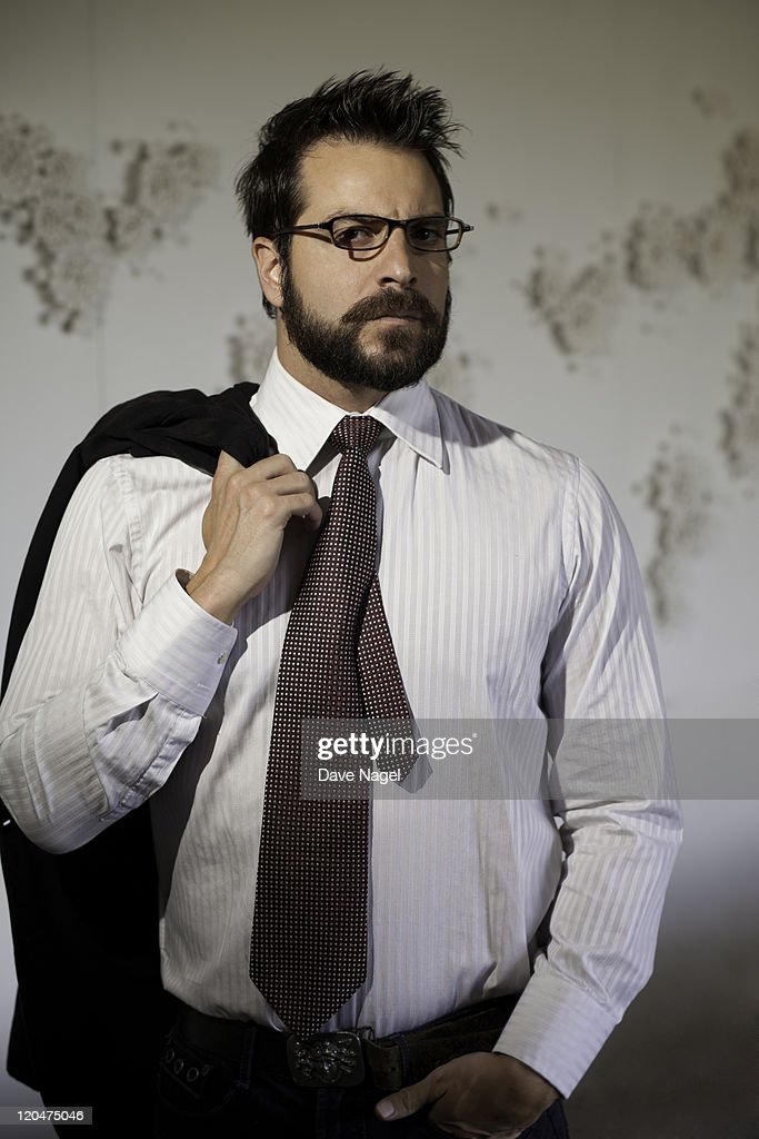 A business man posing for camera. : Stock Photo