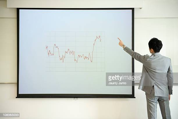 business man presenting using a graph