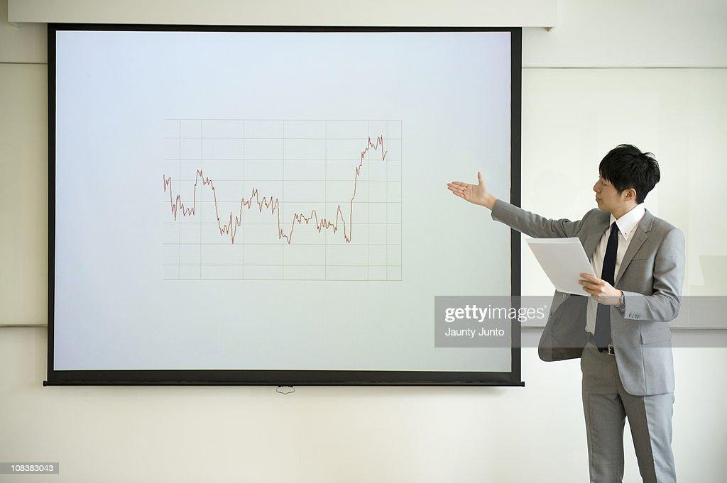 business man presenting using a praph