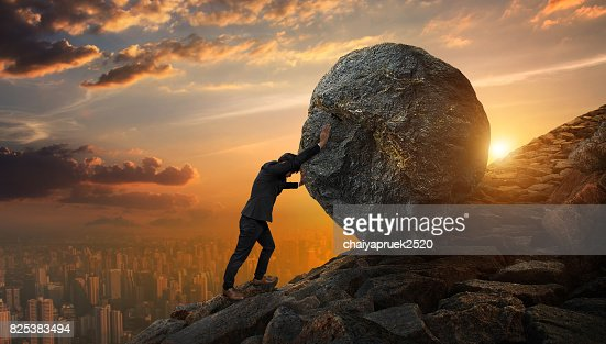 Business man pushing large stone up to hill , Business heavy tasks and problems concept. : Stock Photo