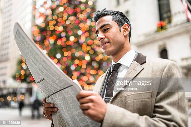 business man reading a newspaper in manhattan