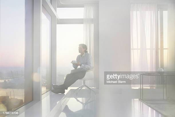 Business man relaxing in City apartment