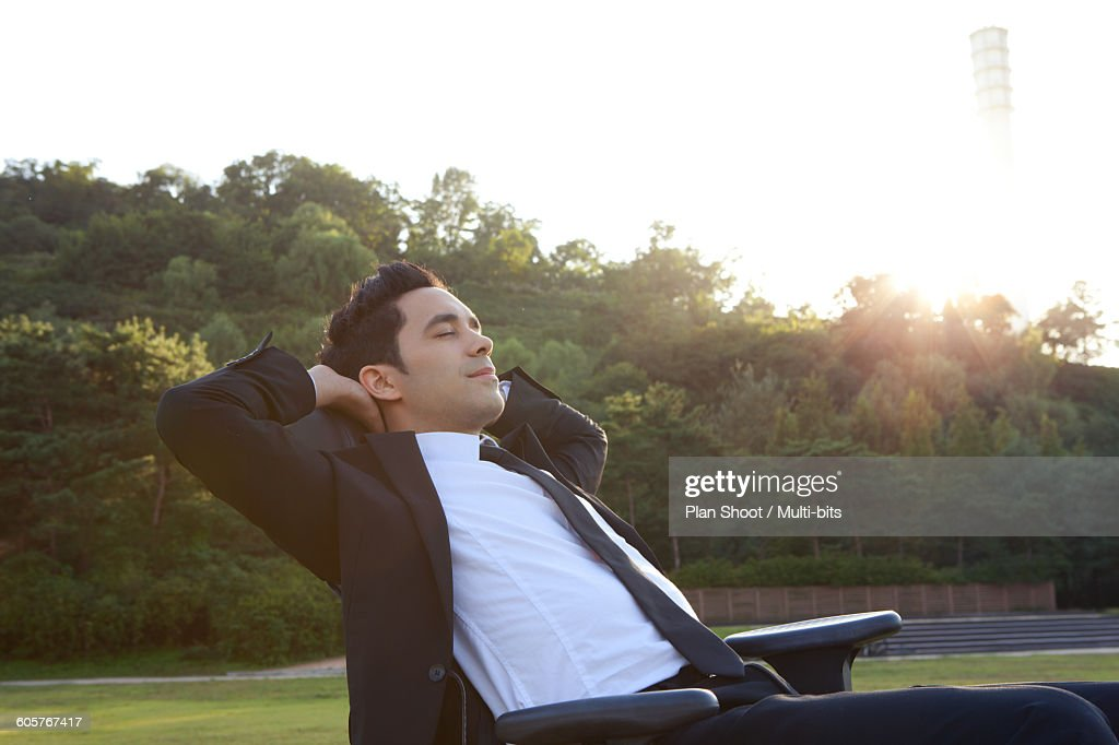 Business man relaxing in the park