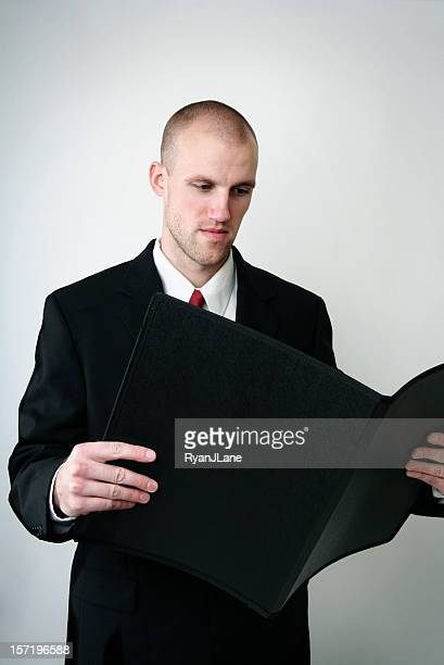 Business Man Reviews His Plans and Documents