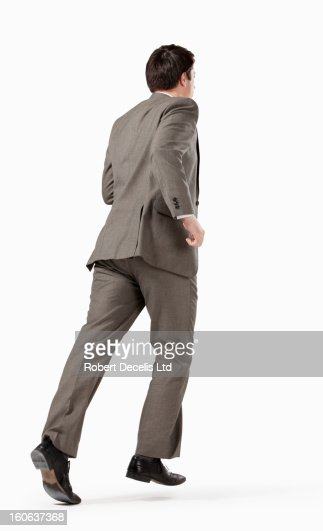 Business Man Running Away From Camera Stock Photo | Getty ...