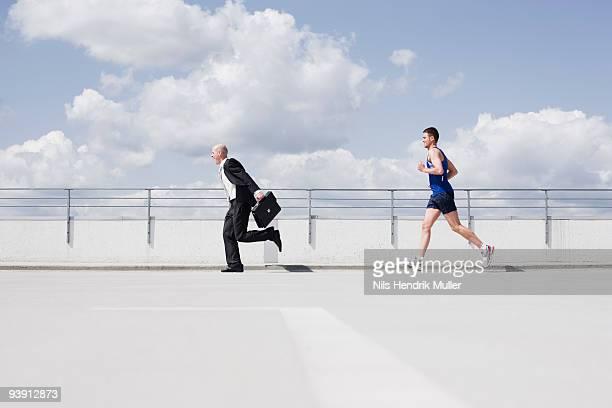 business man running from jogger