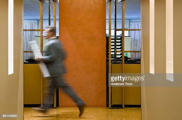 Business man running in the hallways