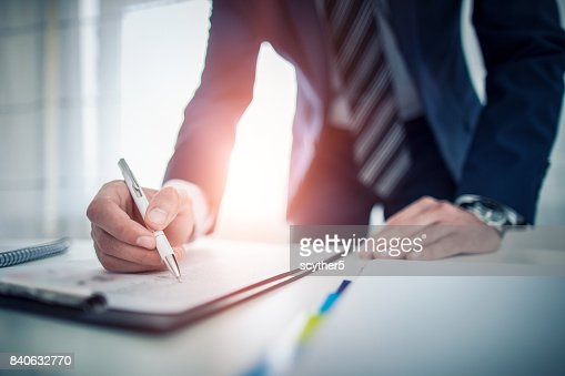 Business man signing contract, making a deal. : Stock Photo