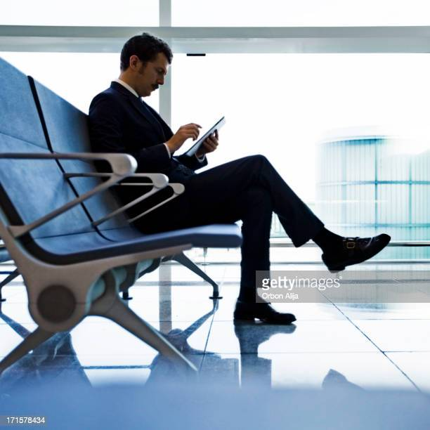 Business man sitting at the airport