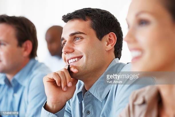 Business man smiling during seminar