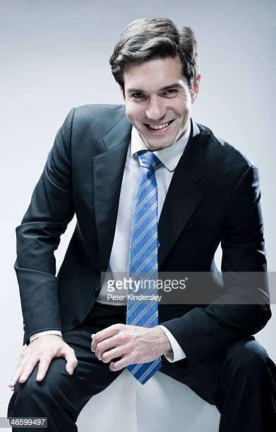 Business man, smiling, in studio shot
