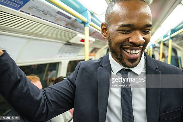 Business man smiling on the subway