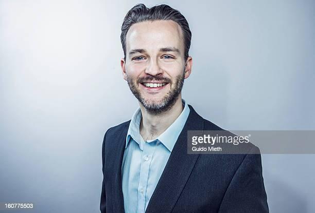 Business man smiling.