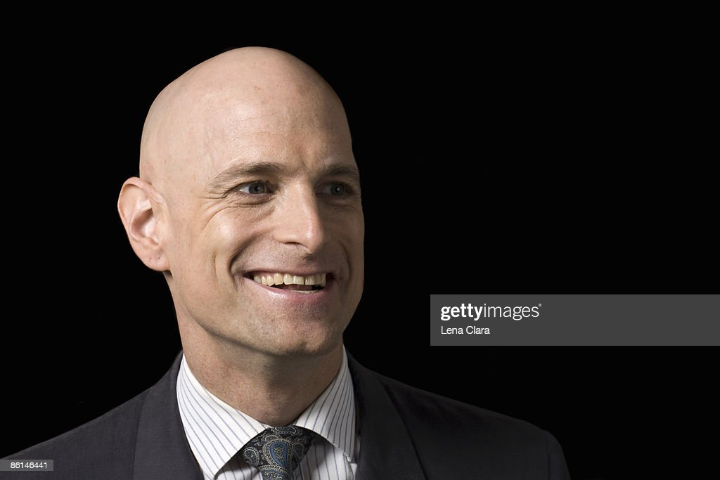 A business man smiling