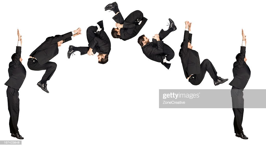business man somersault isolated on white