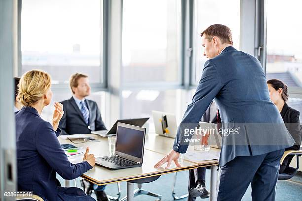 Business man speaking at boardroom meeting