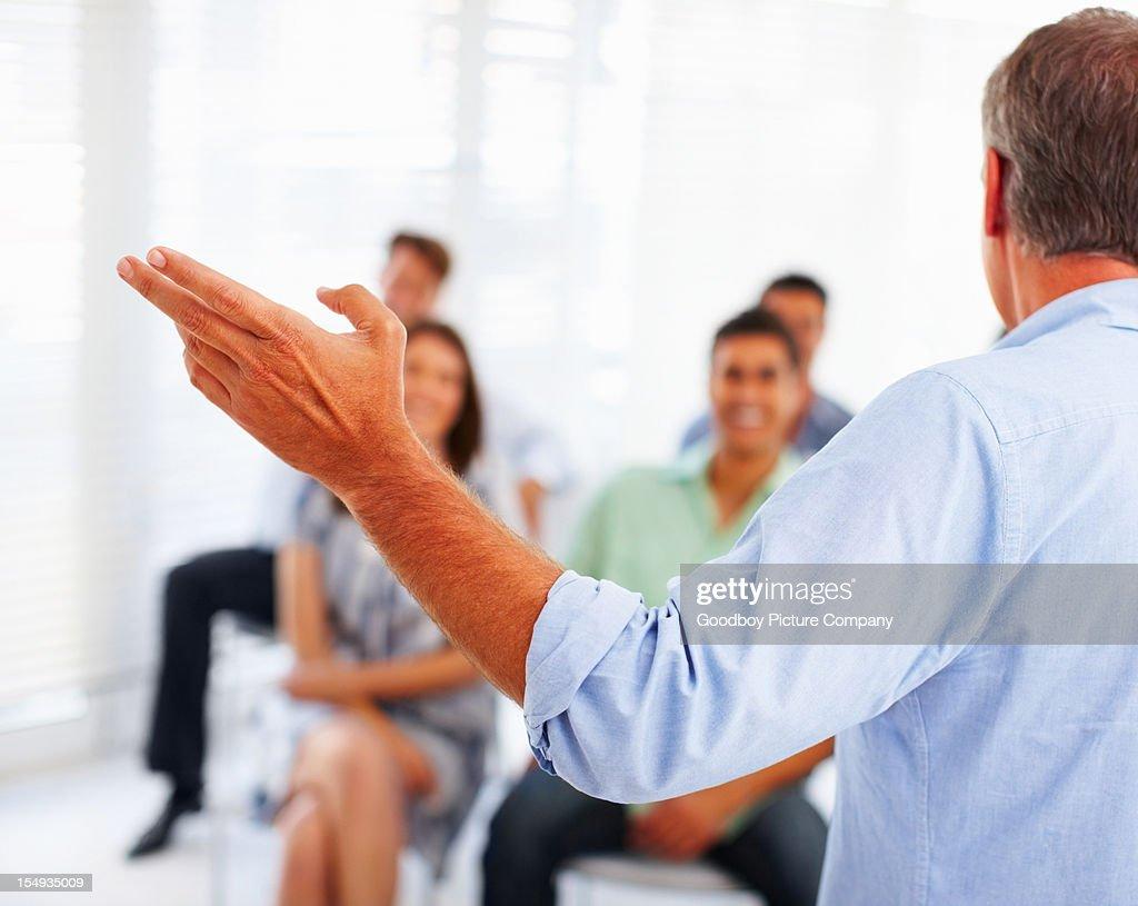 Business man speaking on presentation : Stock Photo