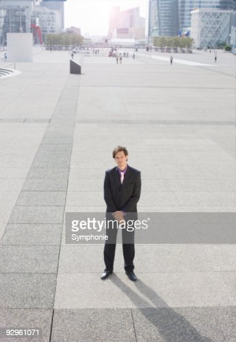 Business man standing in business district : Stock Photo