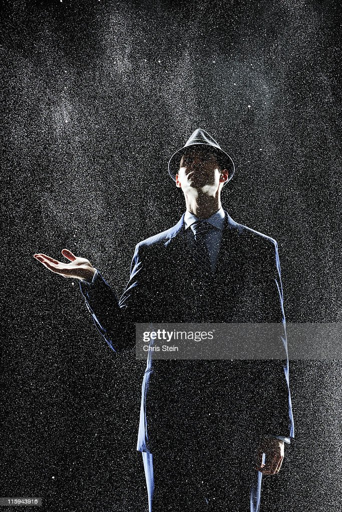 Business Man standing in the rain : Stock Photo
