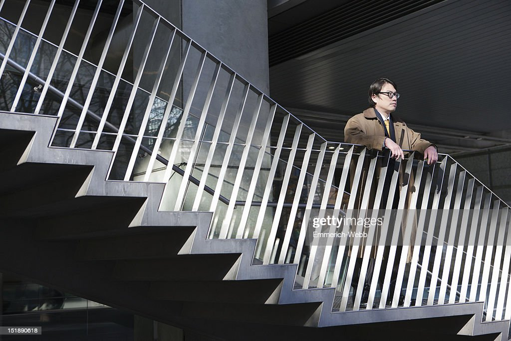 Business Man Standing on Outside Stairway : Stock Photo