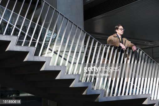 Business Man Standing on Outside Stairway : ストックフォト