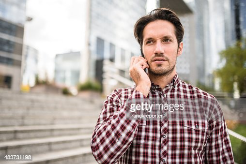 Business man standing on the city on the phone