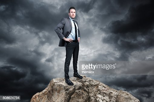 Business man standing on the stones : Stock Photo