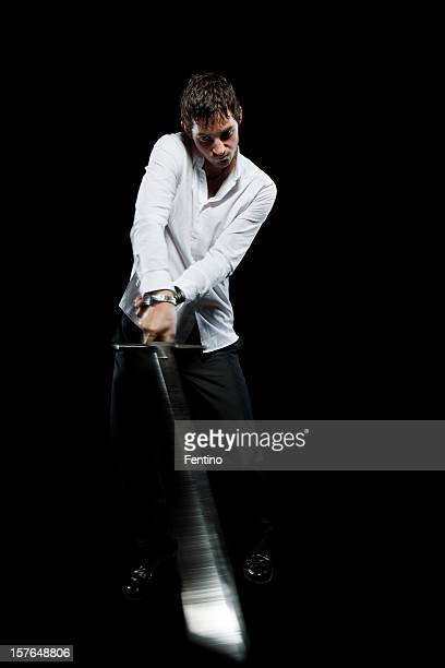 Business Man Striking with a Sword