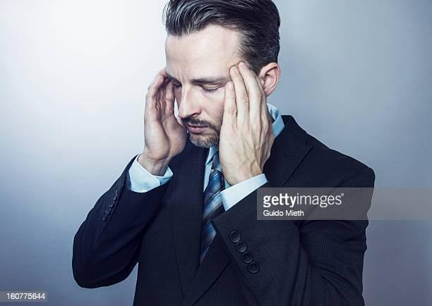 Business man suffer from headaches.