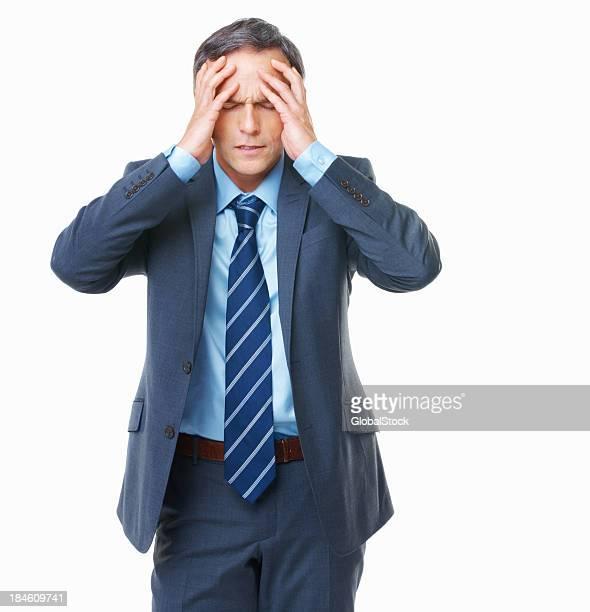 Homem de negócios com dores de cabeça