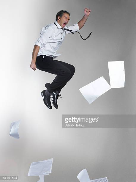 business man suspended in the air, jumping