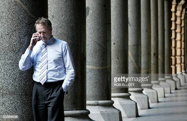 A business man talks on a mobile phone in the streets of Sydney 05 April 2005 as Australia's central bankers met under intense pressure from...