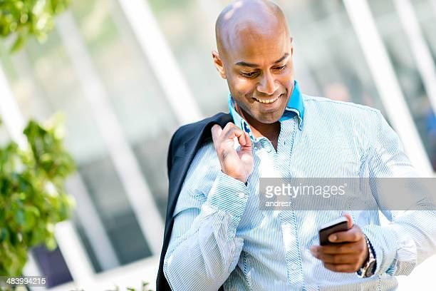 Business man texting on his mobile