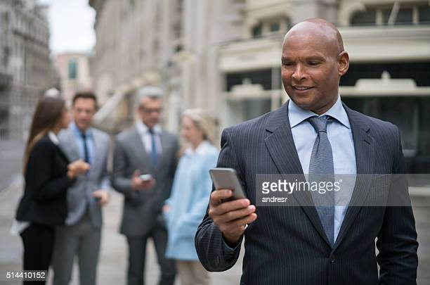 Business man texting on his phone