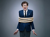 Funny business man tied up with rope screaming for help