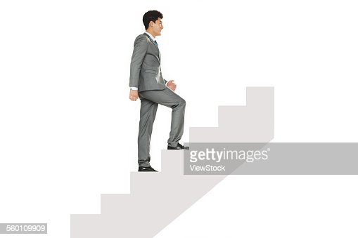 A business man to walk up the stairs