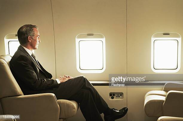Business man travelling aboard a private jet