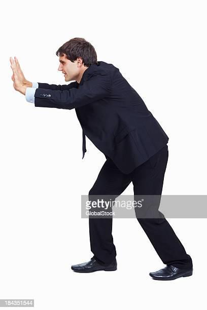 Business man trying to push something