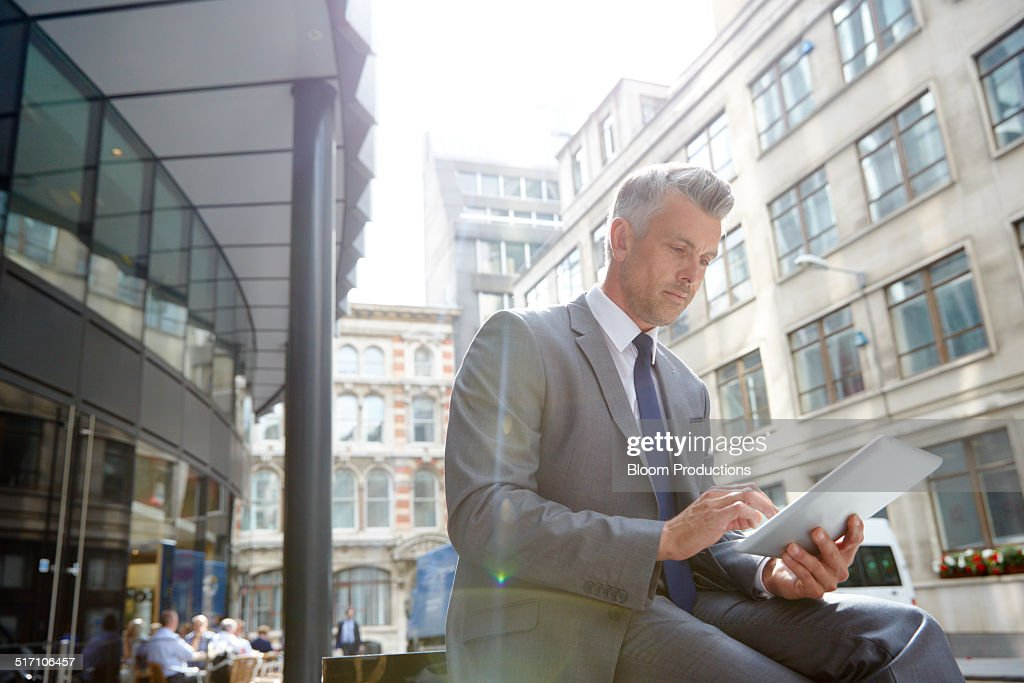 Business man using a digital tablet